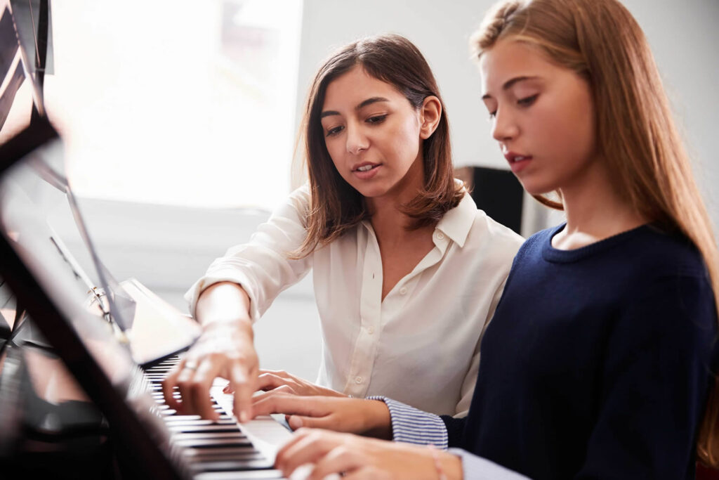 Music teacher instructing student during a private lesson